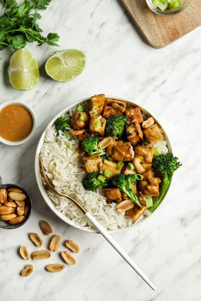 Bowl of peanut tofu with rice and broccolini