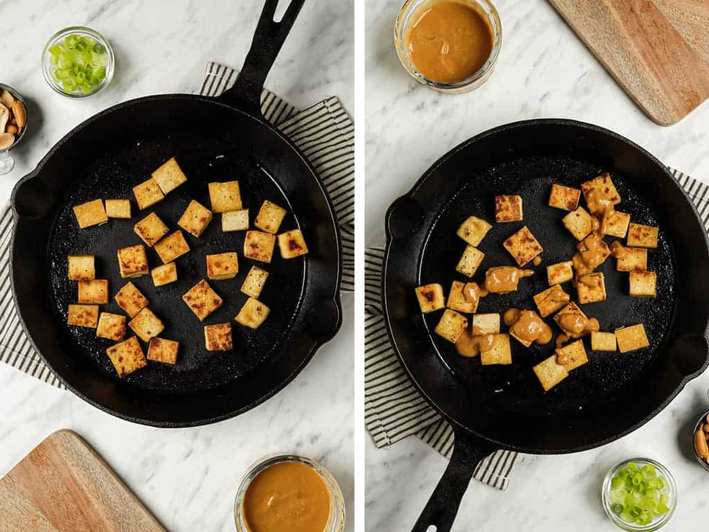 Crispy cubed tofu in a cast iron skillet drizzled with peanut sauce.
