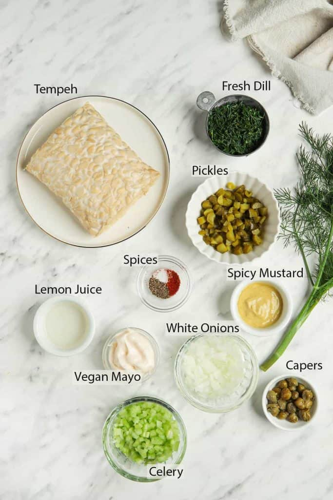 Ingredients for tuna tempeh salad measured out into small dishes