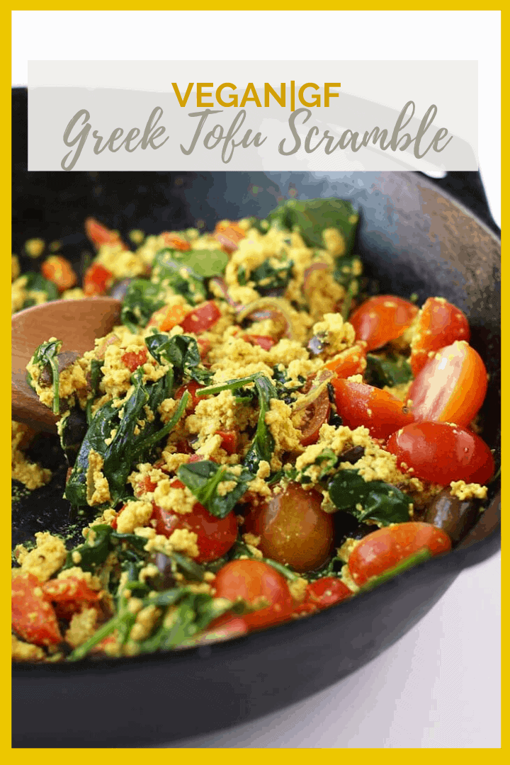 Start your day off right with this hearty and wholesome vegan Greek Tofu Scramble. It is made with seasoned tofu, olives, spinach, and fresh tomatoes for a delicious plant based and gluten free meal.