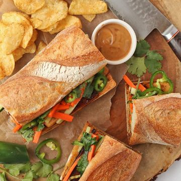 Tofu Banh mi sandwich on a platter with chips