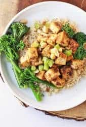 Finished recipe with broccolini and rice on a white plate.