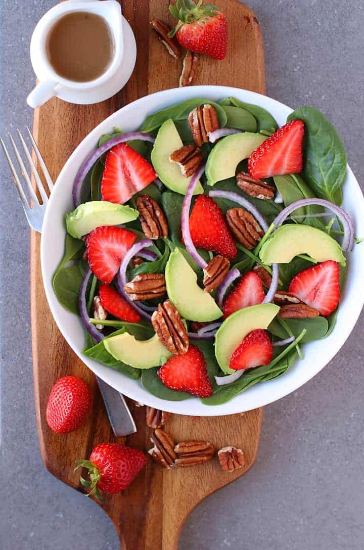 Spinach Strawberry Salad on a wooden platter