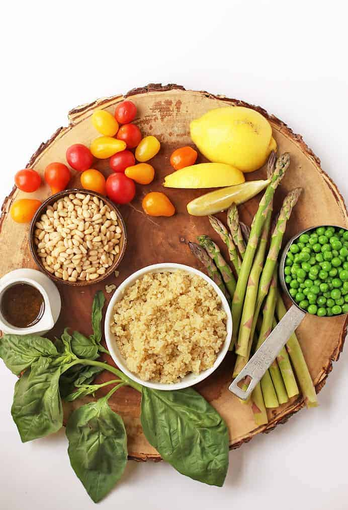 Ingredients for Vegan Quinoa Salad on a wooden platter