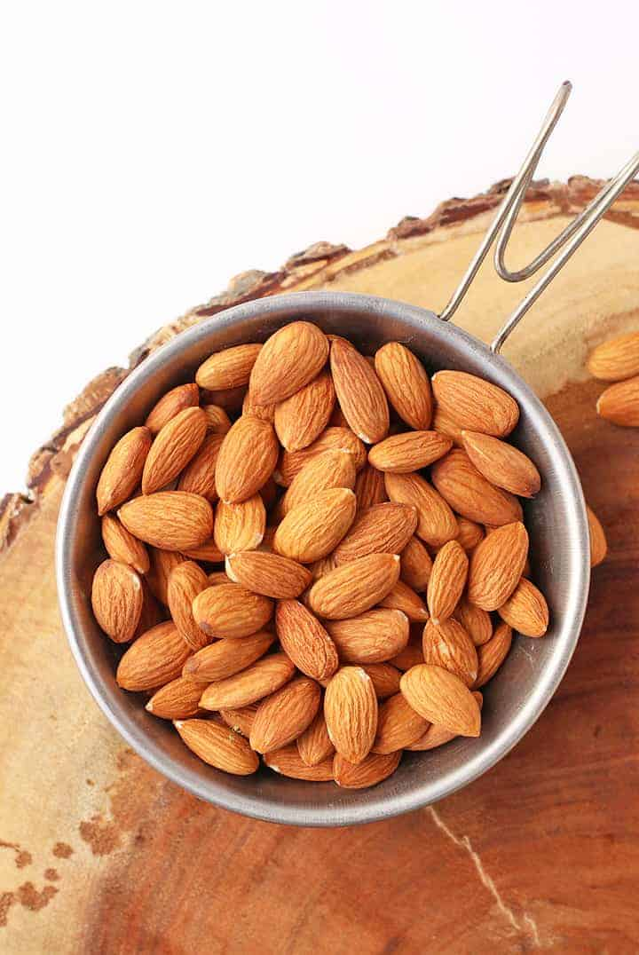Raw almonds in a metal bowl