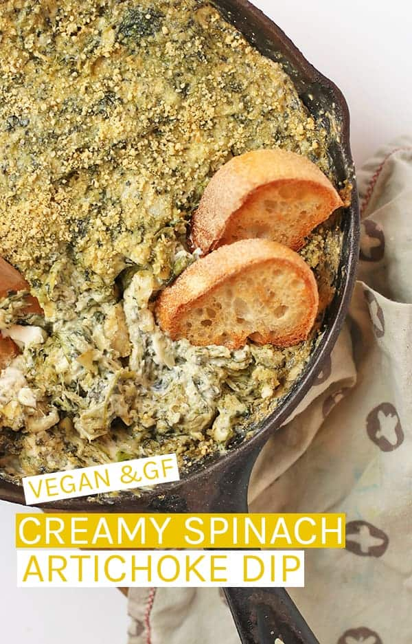 Impress all your friends with this extra creamy and rich vegan Spinach Artichoke Dip - a warm dip or spread that is perfect for your next party. #vegan #veganrecipes #veganappetizers #dips #partyfood #glutenfree #veganglutenfree