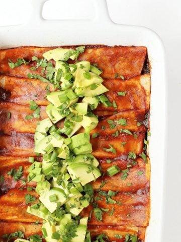 Vegan Enchiladas in a white casserole dish