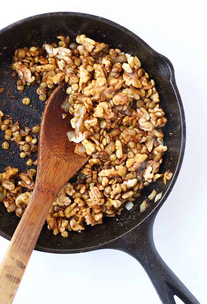 Sautéed onions and walnuts in a skillet