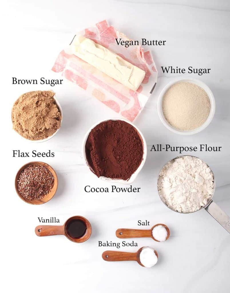 The ingredients for the brownie recipe measured out and placed on a marble background.