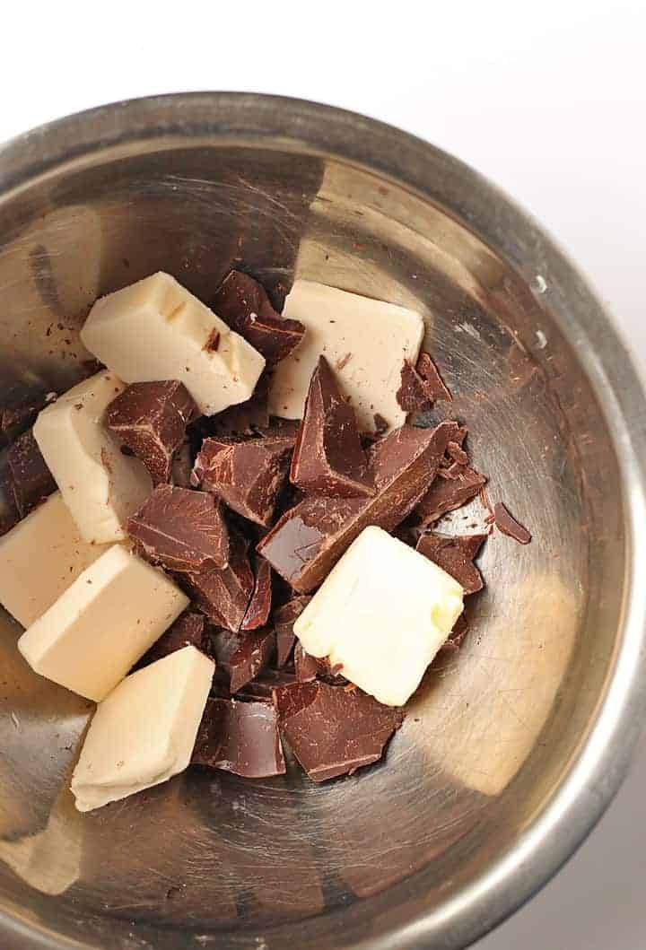 Butter and chocolate in a metal bowl