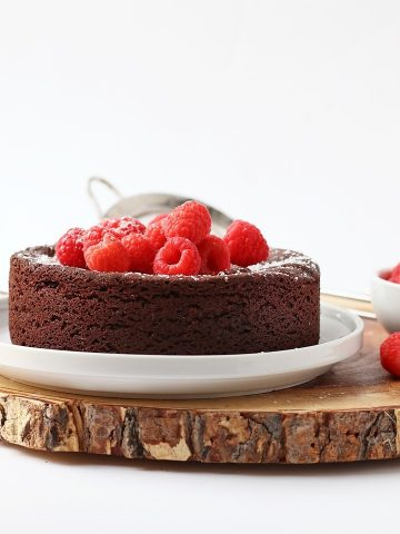 Finished cake topped with fresh raspberries