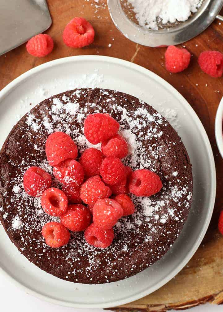 Vegan Flourless Chocolate Cake with raspberries and powdered sugar