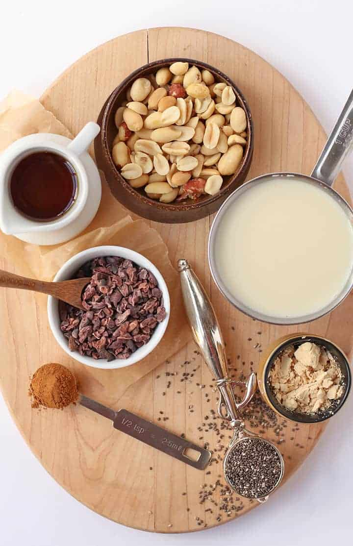 Ingredients for Peanut Cacao Chia Pudding on a wooden platter