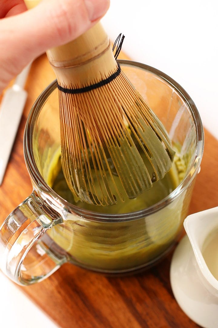 Matcha whisk in a glass mug