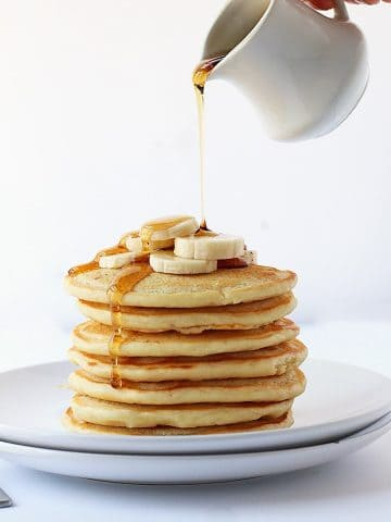 Finished recipe stacked on a white plate with maple syrup