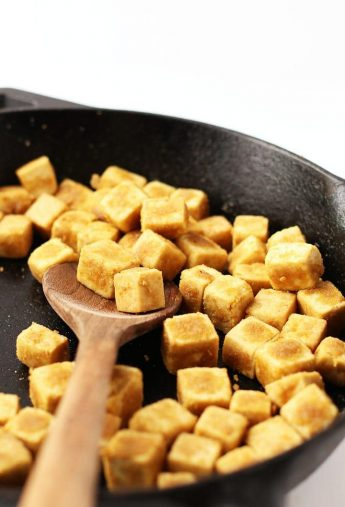 Cubed and sautéd tofu in a skillet