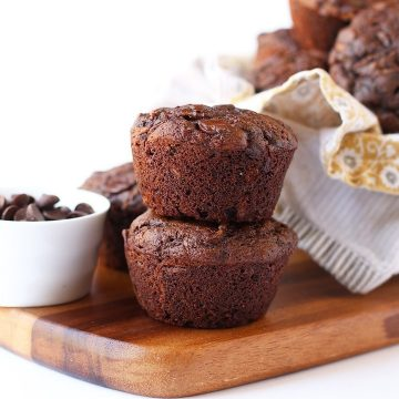 Two chocolate muffins on a wooden board