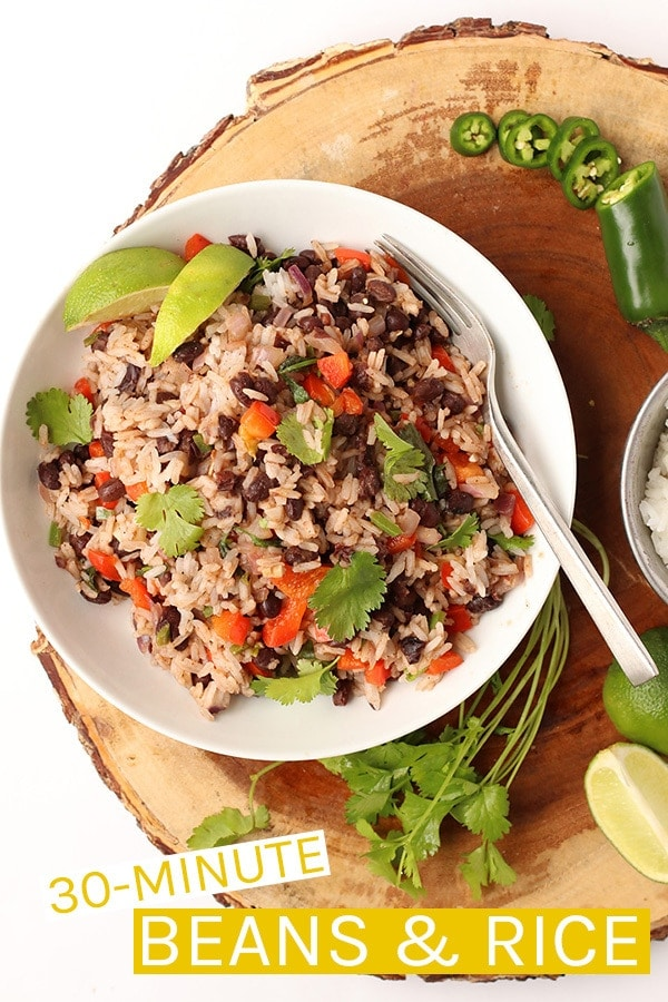 This 30-minute Black Beans and Rice recipe if filled with protein and packed with flavor for a wholesome vegan and gluten-free meal. Delicious and so easy to make, it should be part of your weekly rotation. #vegan #glutenfree #veganrecipes #riceandbeans #easydinners