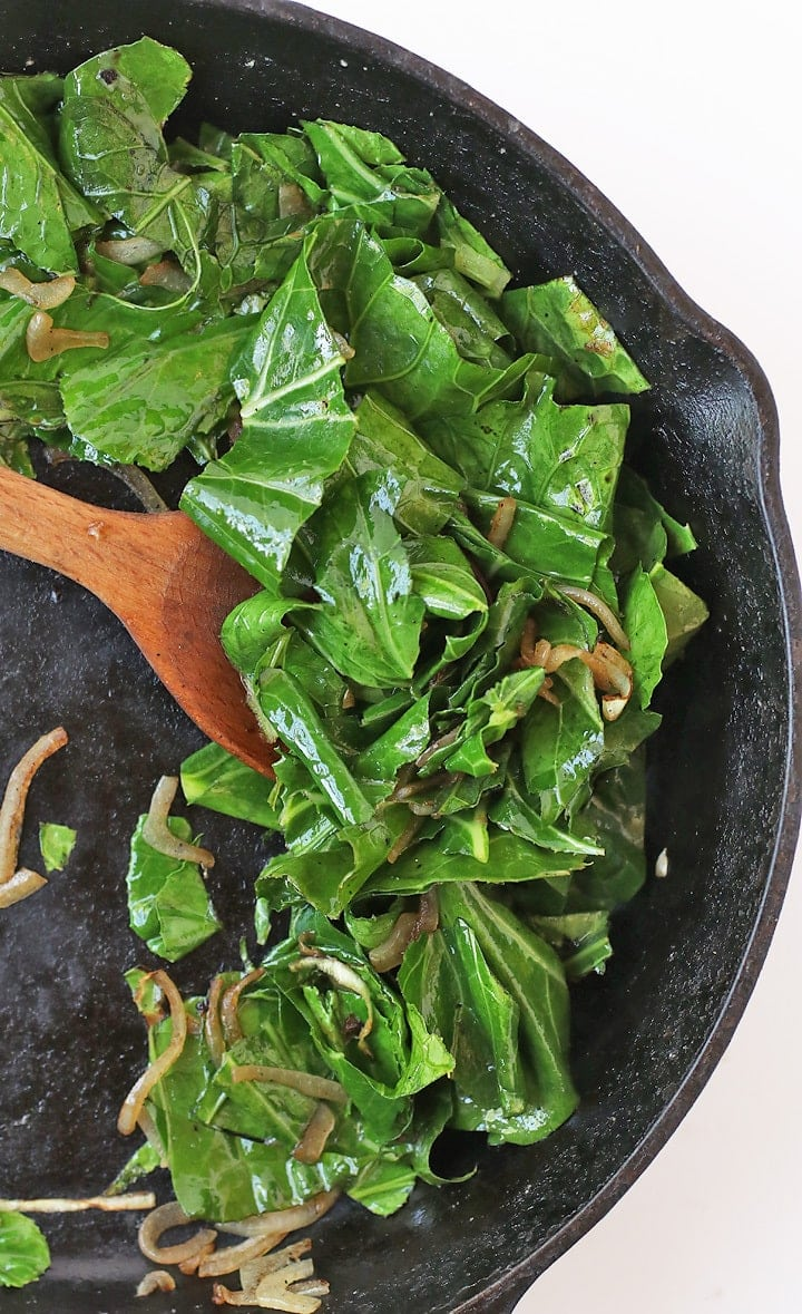 Sautéed Collard Greens in a cast iron skillet.