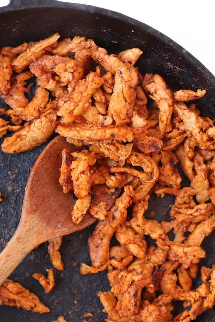 Cooked BBQ Soy Curls in a cast iron skillet