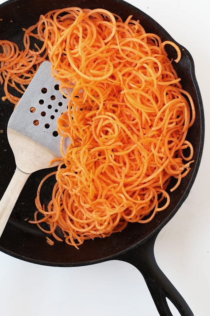Sautéed Sweet Potato Noodles in a cast iron skillet
