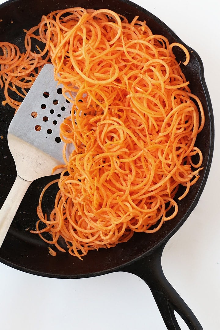 Spiralized Sweet Potatoes cooked in a cast iron skillet