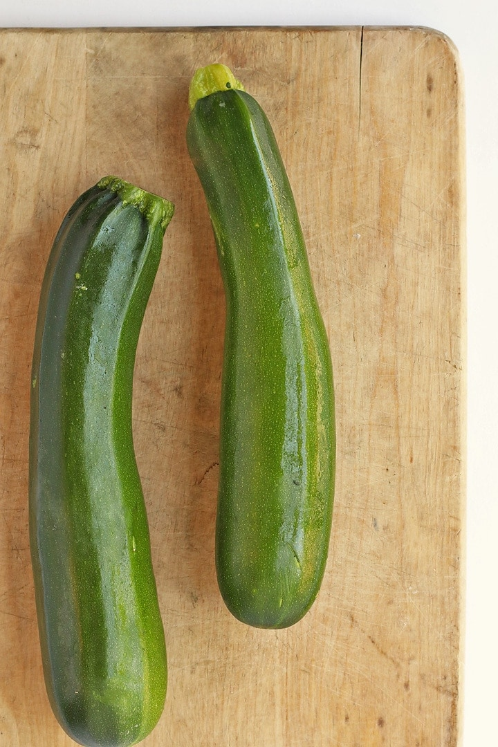 Two zucchinis on a cutting board