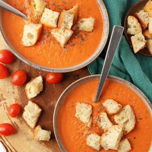 Finished soup in two bowls served with croutons