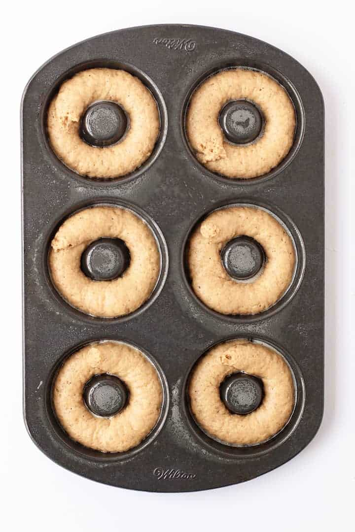 Apple Cider Doughnuts piped into a doughnut pan