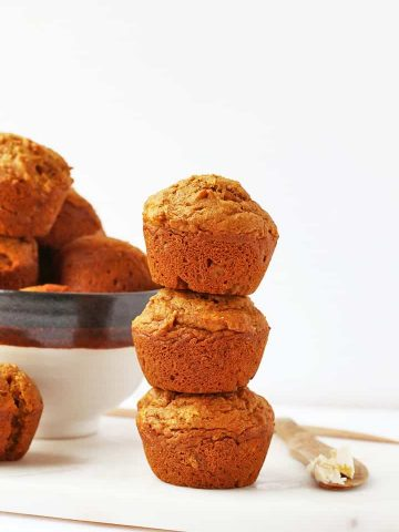 Stack of vegan muffins next to a bowl