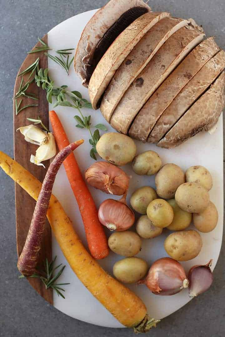 Ingredients for Vegan Pot Roast on a white marble patter.