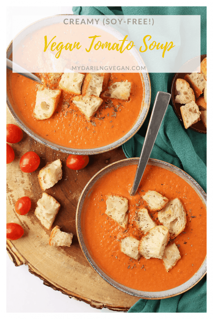 Warm up with this rich and creamy vegan tomato soup. A thick tomato base mixed with cashew cream and topped with homemade croutons for a satisfying fall soup. Made in under 20 minutes!
