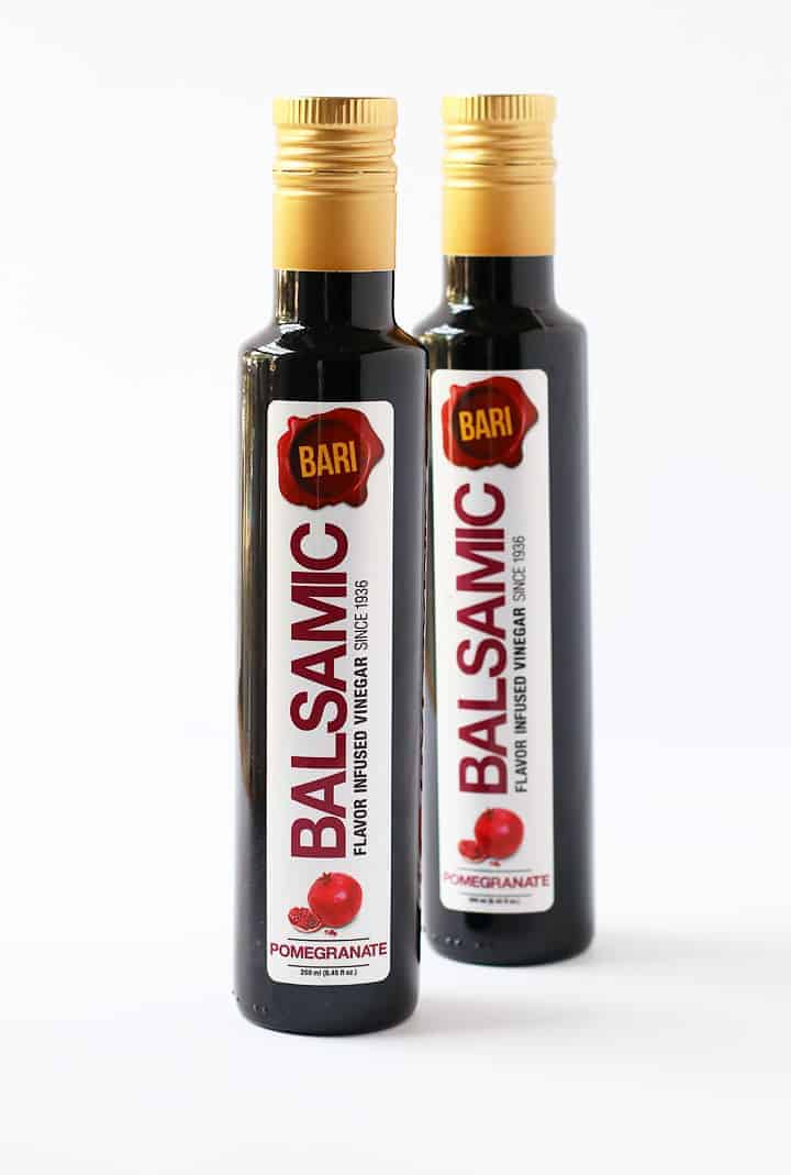 Two bottles of Bari's Pomegranate Balsamic Vinegar.