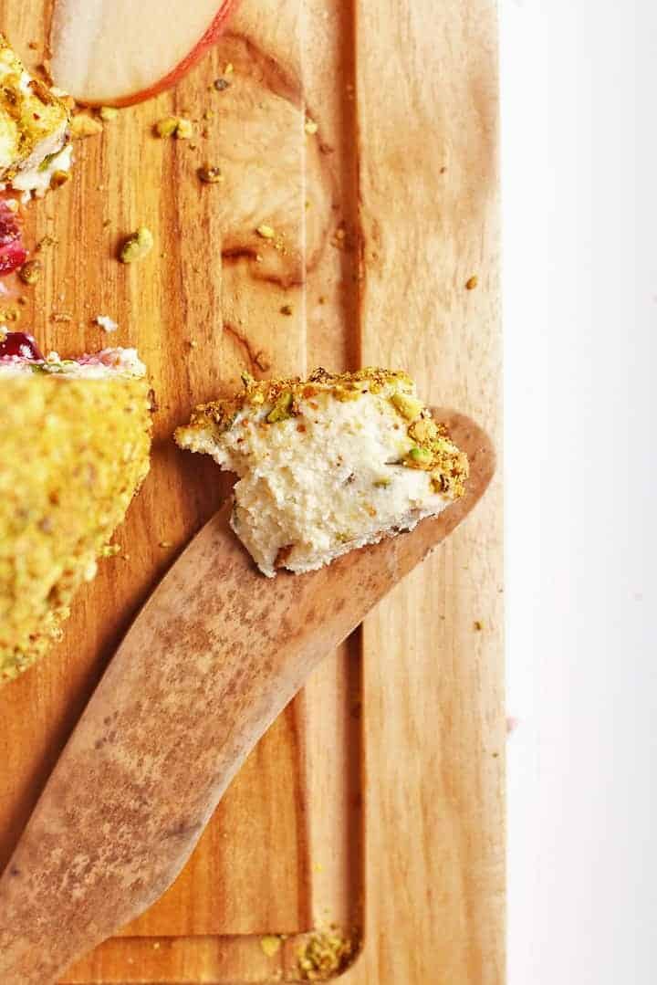 Vegan Cheese Ball wedge on a wooden knife