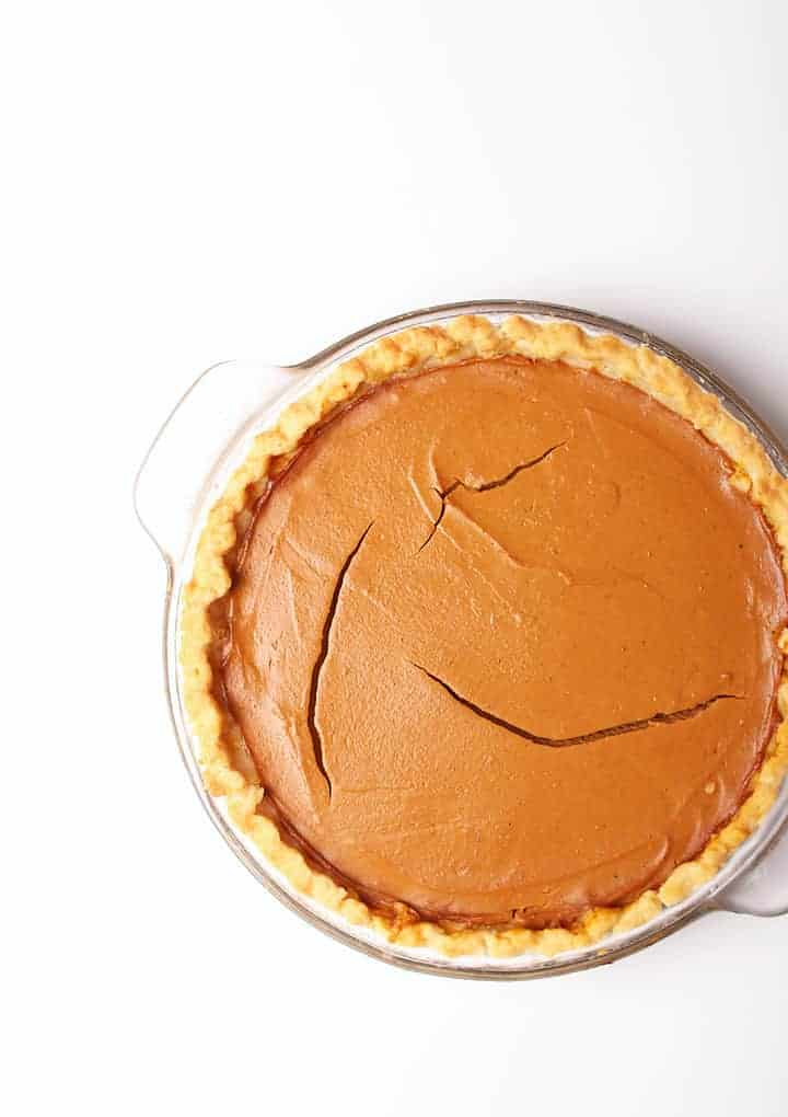 Baked Vegan Pumpkin Pie on white background.