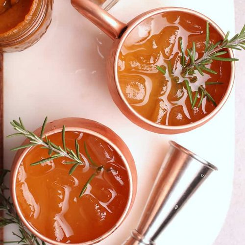 Moscow Mule recipe in a copper mug with rosemary.