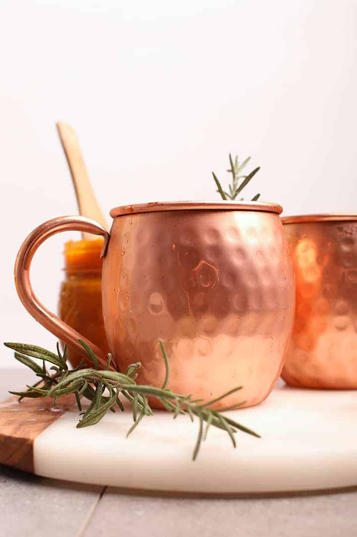 Moscow Mule recipe in a copper mug with rosemary