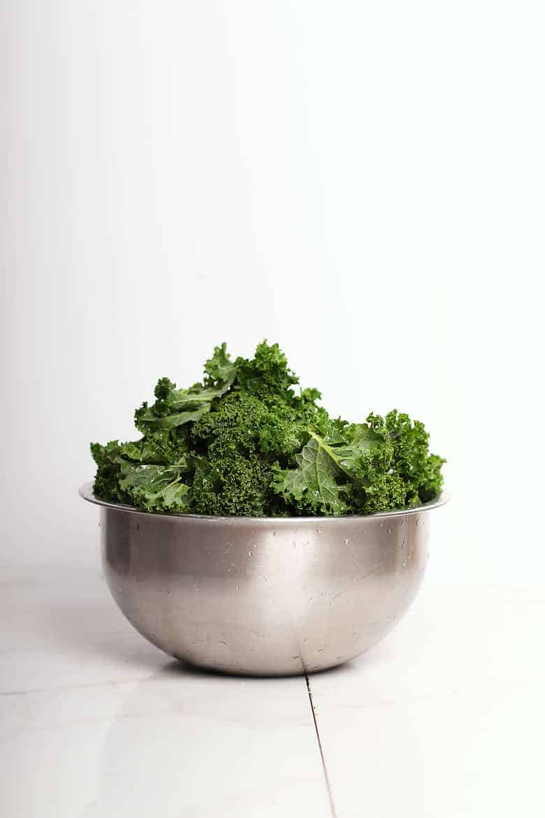 Curly kale in a metal bowl