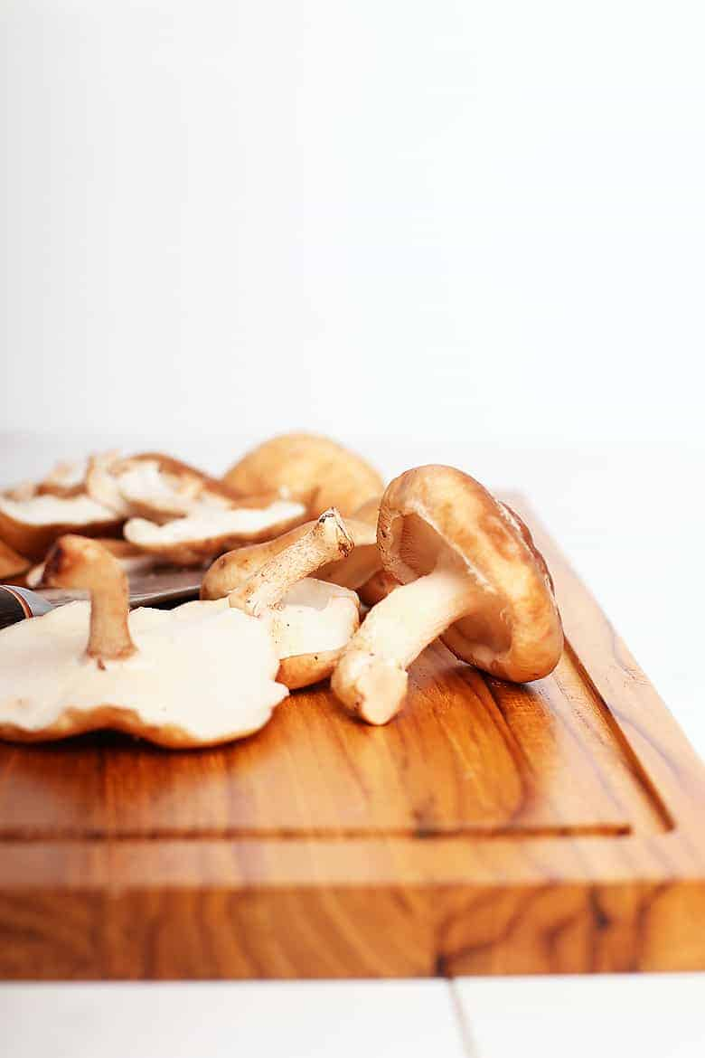 Shiitake mushrooms on a cutting board