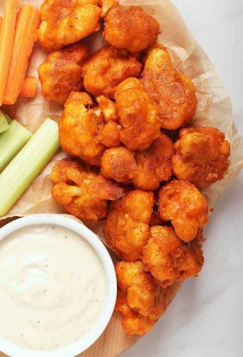 Cauliflower Buffalo Wings with ranch dressing and celery
