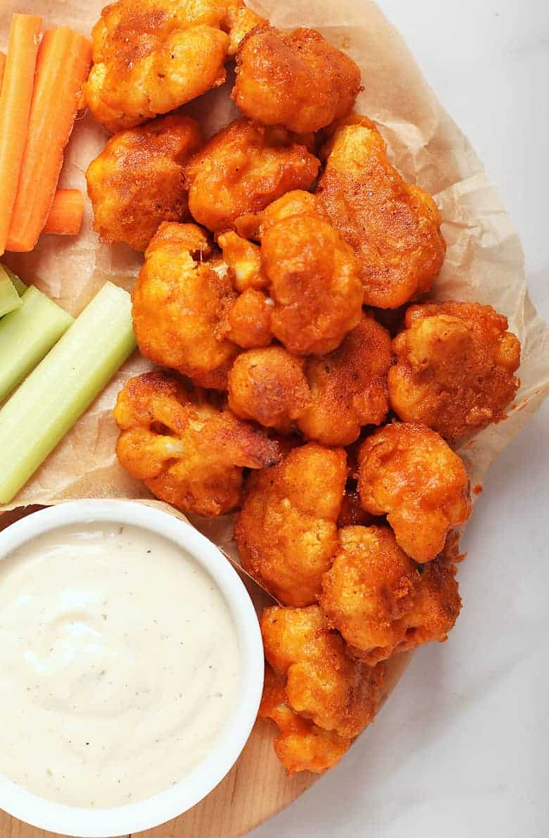 Buffalo Cauliflower Wings with ranch dressing and celery