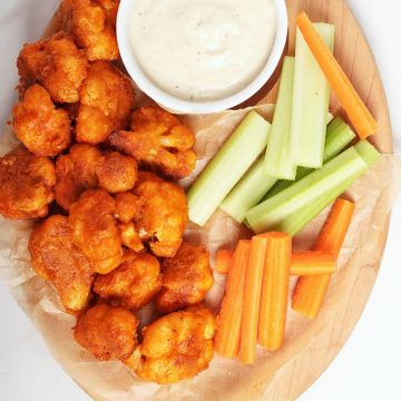 Buffalo Cauliflower Wings with ranch and carrot sticks