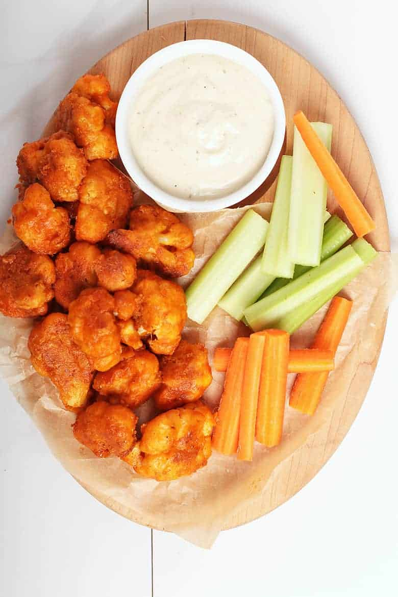 Plate of Buffalo Cauliflower Wings with ranch, celery, and carrots