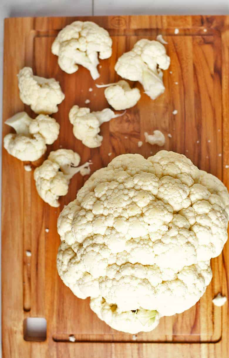 Cauliflower florets on cutting board