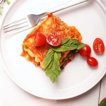 Finished dish on a white plate with basil
