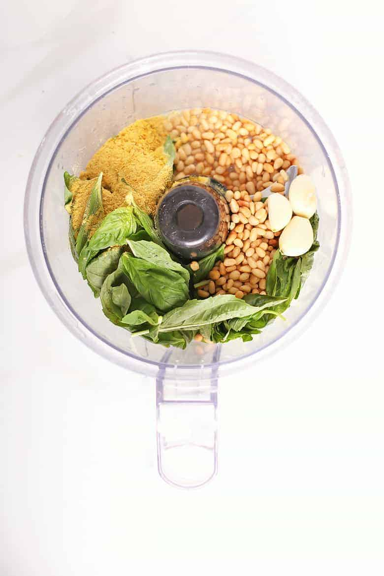 Basil, pine nuts, garlic, and nutritional yeast in a food processor