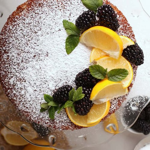 Whole cake with lemons and blackberries