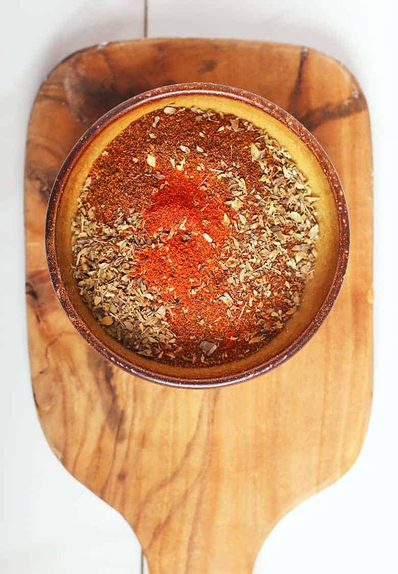 bowl of chili spices on a cutting board