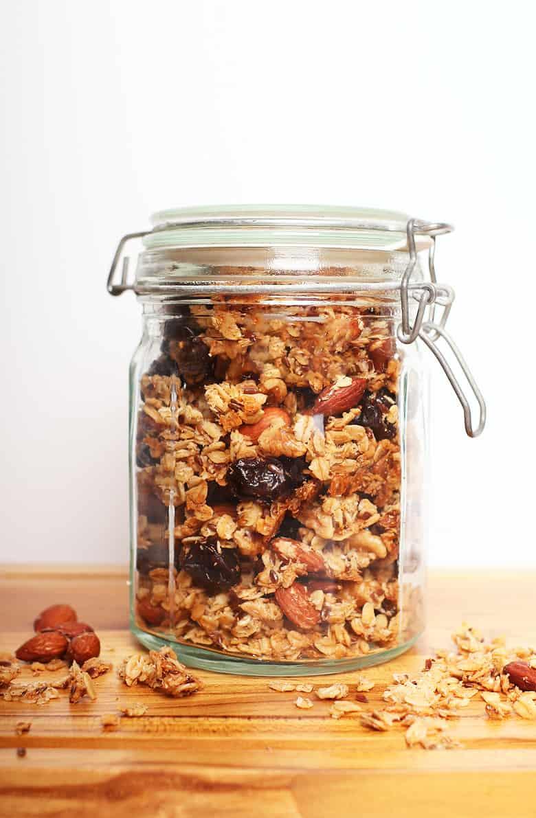 Homemade granola in a jar on a cutting board