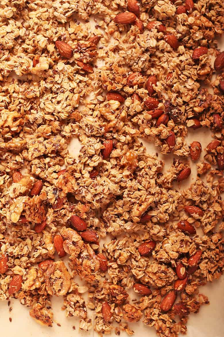 Baked homemade granola on a baking sheet